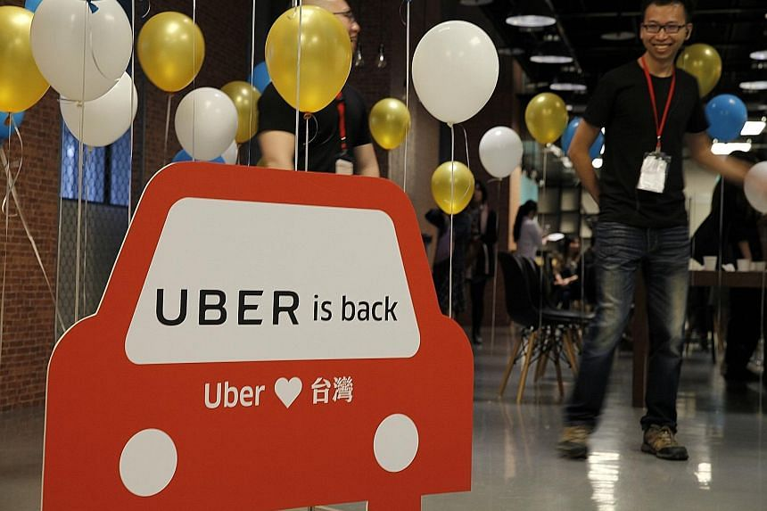 A press conference yesterday announcing the return of Uber's ride-hailing service. Local taxi firms and the Taiwanese authorities had earlier this year accused Uber of misrepresenting its service.