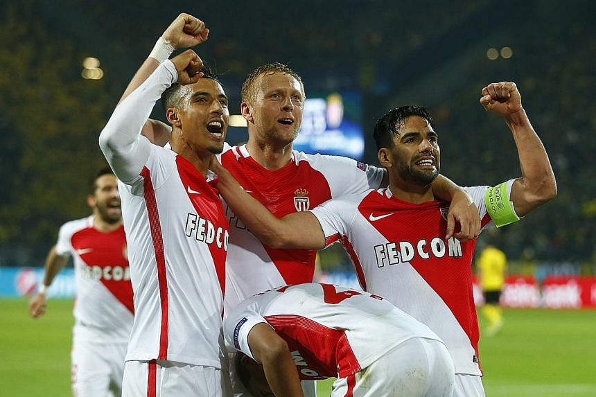Above: Monaco captain Falcao leads the celebrations with his team-mates after the French side score their third away goal in Dortmund.
