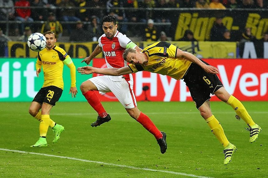 Above: A horror start for Dortmund, as Sven Bender's own goal while fending off Radamel Falcao puts Monaco 2-0 ahead in the 35th minute.