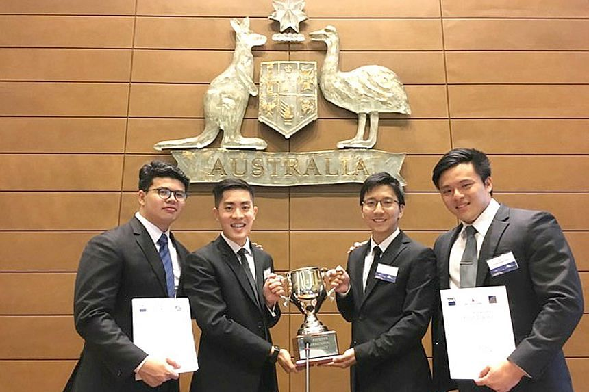 Singapore Management University students (from left) Pang Weng Fong, Gary Leow, Benedict Chan and Goh Yong Ngee with their championship trophy after winning the inaugural Ian Fletcher International Insolvency Law Moot Competition, held in Sydney, Aus