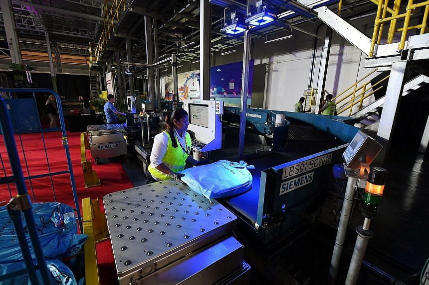 At the Sats facility, mail bags are placed on conveyor belts, sorted and dispatched to different chutes.
