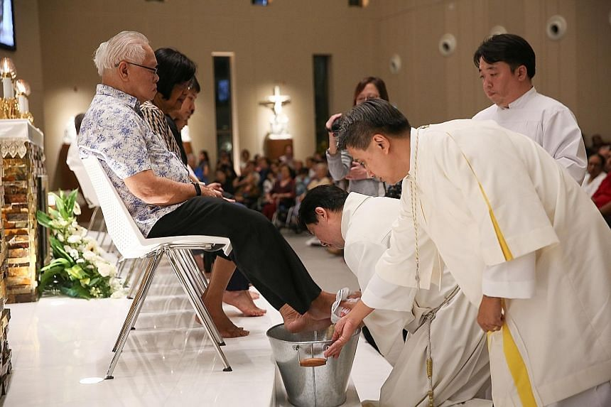 Father Joachim Chang washing the feet of 12 churchgoers in a Maundy Thursday tradition during Mass last night at Singapore's newest Catholic church, the Church of the Transfiguration, in Punggol. The deed was a re-enactment of biblical history, when