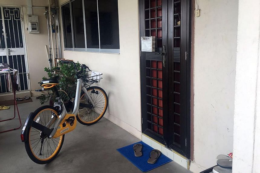 A bicycle belonging to oBike, one of three bike-sharing companies in Singapore, parked outside an 11th-storey Housing Board flat in Yishun. There have been incidents of such two-wheelers being taken home, vandalised or not parked at proper locations