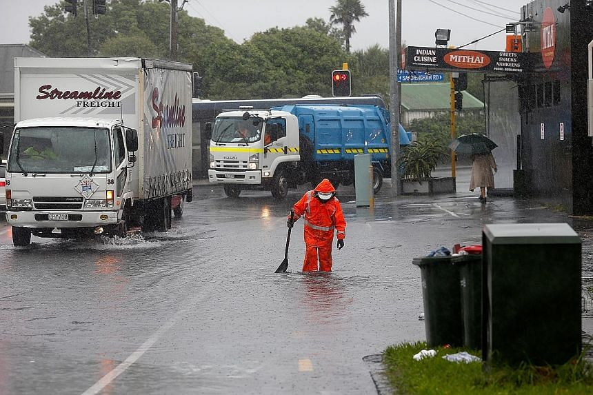 """Parts of Mt Albert Road in Auckland were flooded on Wednesday. Despite a weather warning for the city as Cyclone Cook approached, """"it seems Auckland has largely survived... unscathed"""", its mayor tweeted."""