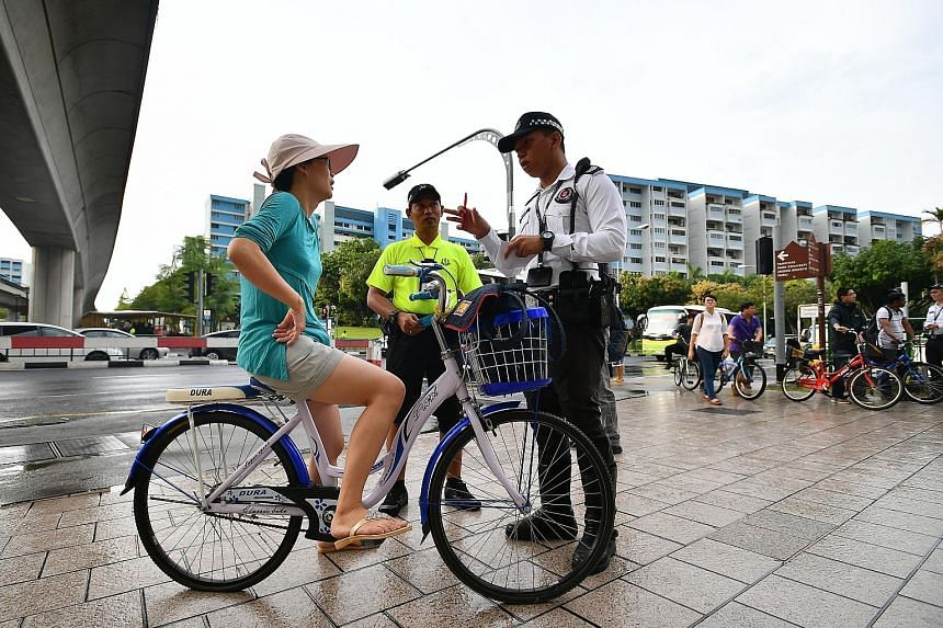 Mrs Queena Wee received pointers on safe riding practices from Land Transport Authority and Traffic Police officers yesterday.