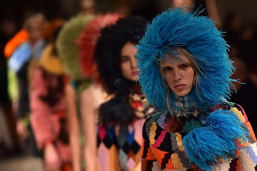 Prada creations being paraded at the Women's Fall/Winter 2017/2018 fashion week in Milan in February. The company has seen sales return to growth in January, an initial sign that it is on the mend, and hopes to speed up recovery by boosting e-commerc