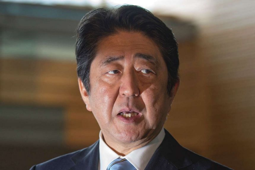 Japan's Prime Minister Shinzo Abe, speaking to reporters at his official residence in Tokyo, on April 5, 2017, after North Korea launched a ballistic missile into the Sea of Japan.