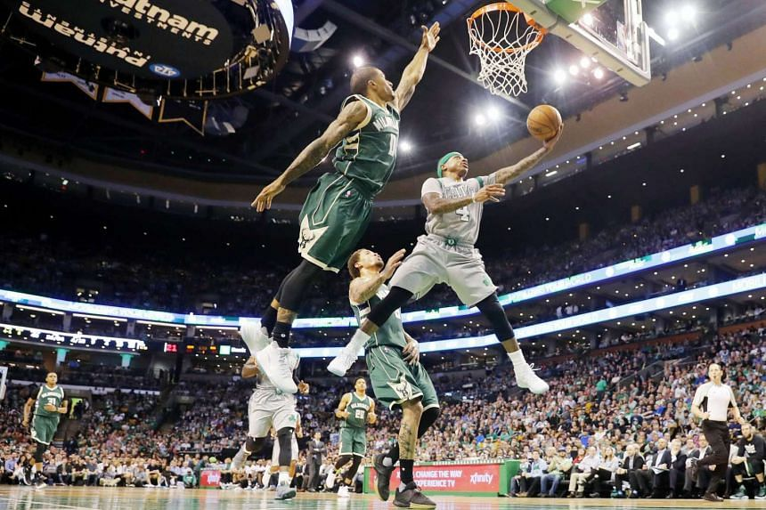 Celtics guard Isaiah Thomas goes to the basket around Bucks guard Gary Payton II (No. 0) during Boston's 112-94 win over Milwaukee. The Celtics finished the regular season with a 53-29 record, topping the Eastern Conference for the first time since 2007-0