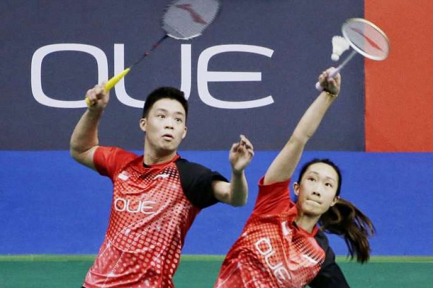 Singapore's Terry Hee and Tan Wei Han taking China's All England champions Lu Kai and Huang Yaqiong the distance in their Singapore Open round of 16 clash at the Singapore Indoor Stadium.