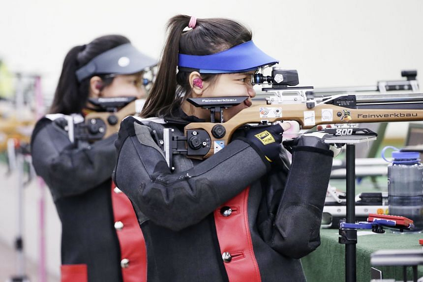 A mentally stronger Ho Xiu Yi (right) of Singapore Sports School beat her schoolmate Adele Tan by 3.2 points for the A Division 10m air rifle title at Yishun Safra.