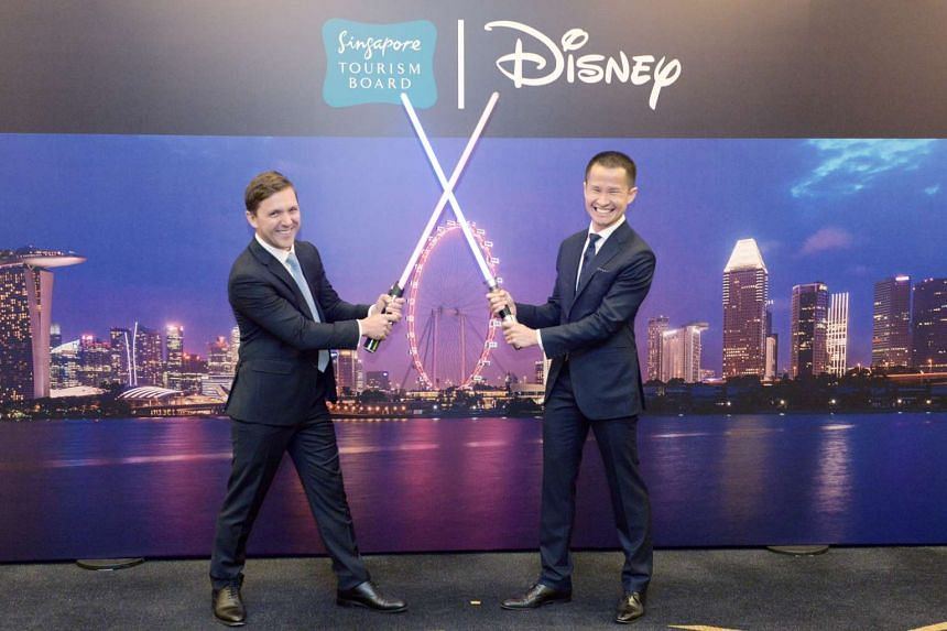 Mr Alex Baillie (left), head of marketing and partnerships at The Walt Disney Company South-east Asia, and Singapore Tourism Board (STB) chief executive Lionel Yeo, at STB's annual tourism conference.