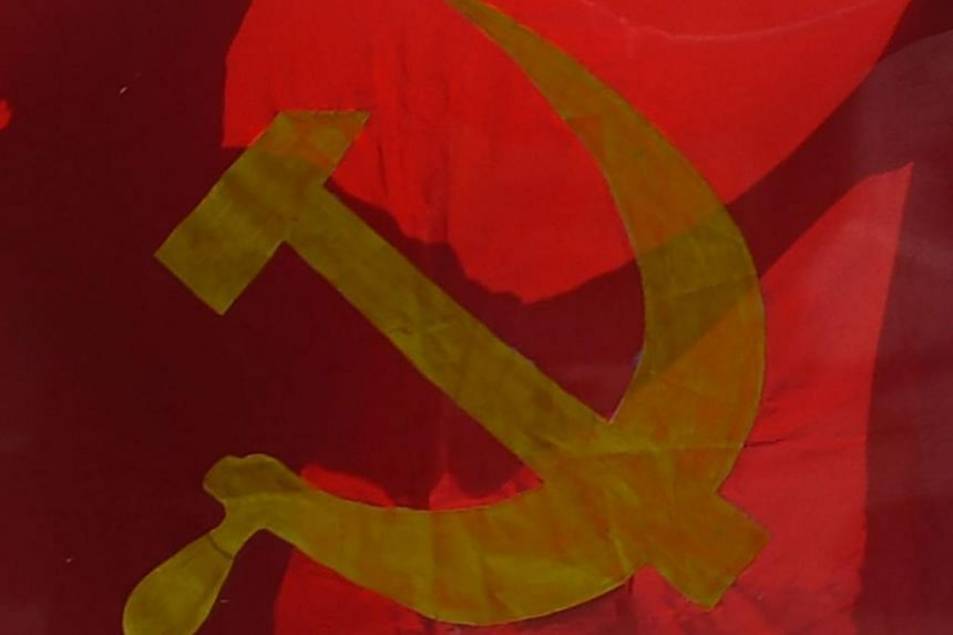 The man was wearing a T-shirt with an image of the communist hammer and sickle symbol that has been banned in Indonesia.