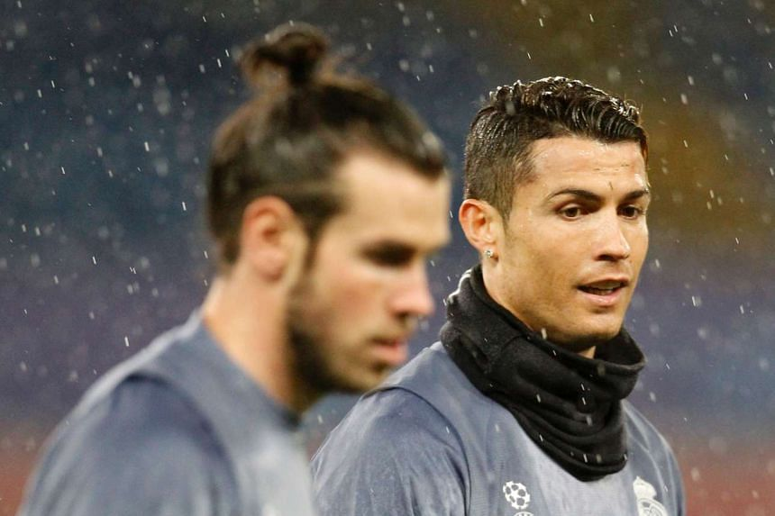 Cristiano Ronaldo (right) and Gareth Bale at a training session under heavy rain on March 6, 2017.