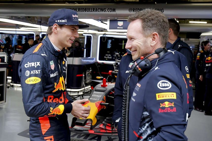 Dutch Formula One driver Max Verstappen (left) of Red Bull Racing talks with Red Bull Racing team chief Christian Horner.