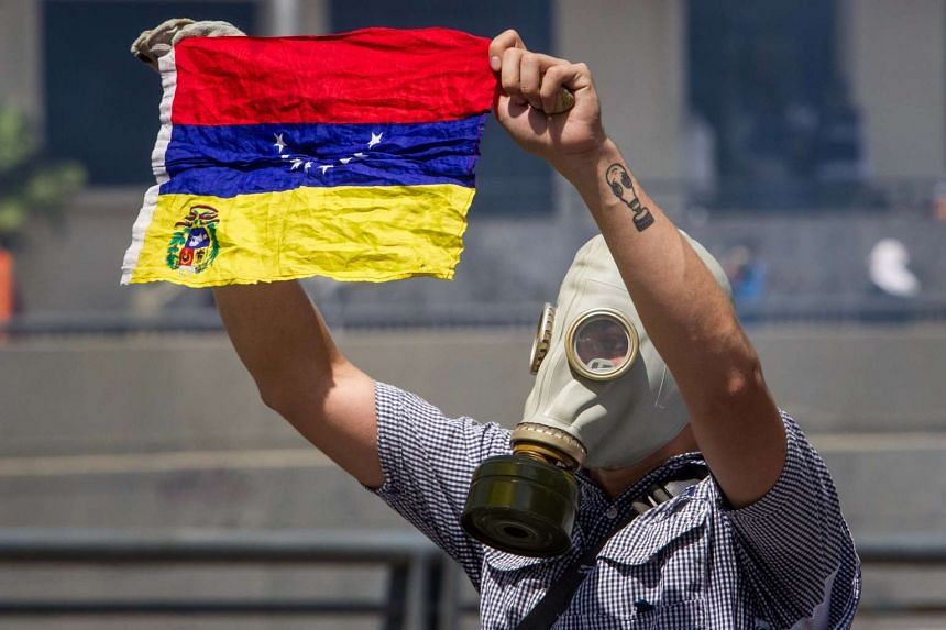 Demonstrators clash with police during a protest in Caracas, April 8, 2017.
