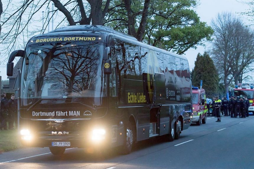 A view on the damaged Borussia Dortmund team bus after it was hit by three explosions, April 11, 2017.