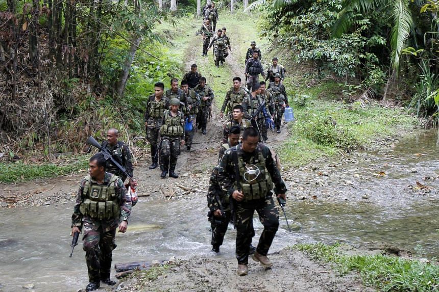 Philippine army soldiers patrolling in the town of Ibanga, Bohol island, after clashes with Abu Sayyaf militants in the area, on April 12, 2017.