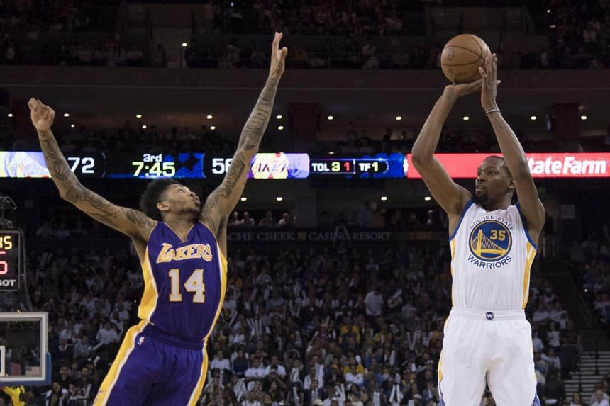 Golden State Warriors forward Kevin Durant (right) shoots the basketball against Los Angeles Lakers forward Brandon Ingram during their NBA basketball game at Oracle Arena on April 8, 2017.