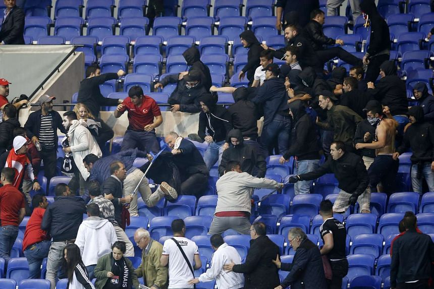 Supporters of Besiktas and Olympique Lyon clash in the stands on April 13, 2017.