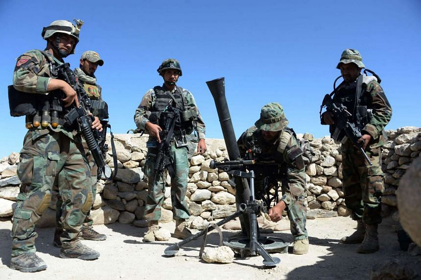 Afghan commandos preparing to launch mortar shells on an Islamic State (IS) militant stronghold in Achin district of Nangarhar, eastern Afghanistan, on April 14, 2017.