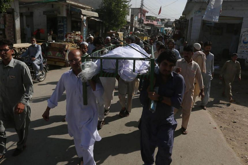 Pakistani relatives and residents carrying the coffin of student Mashal Khan, who was killed by his classmates, during his funeral on April 14, 2017.