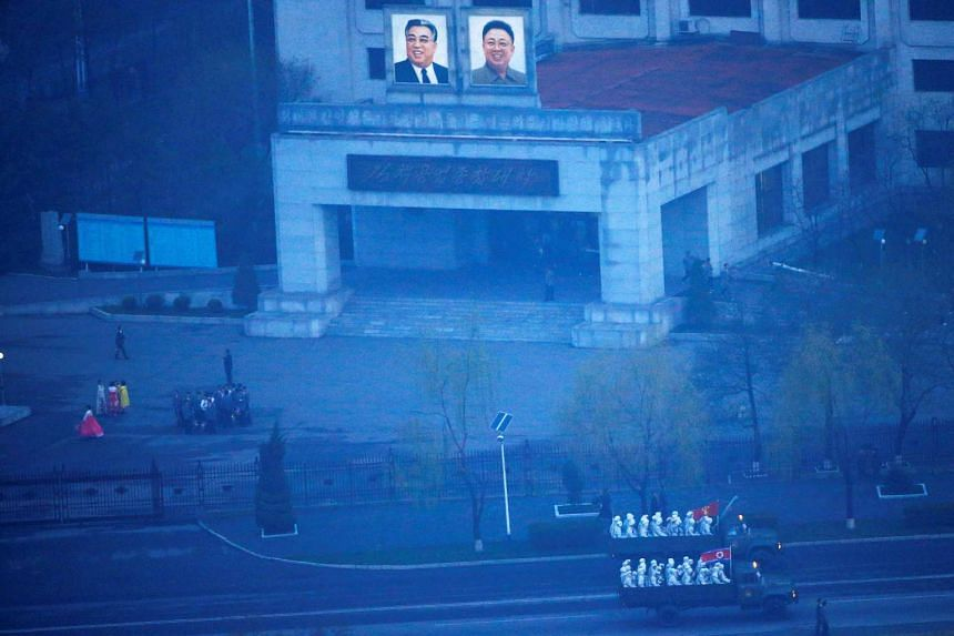Military trucks carry soldiers through central Pyongyang before sunset as the capital preparers for a parade marking today's 105th anniversary of the birth of Kim Il Sung.
