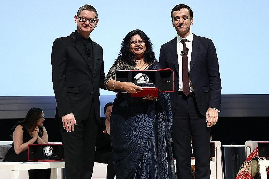 Naireeta Services founder Trupti Jain receiving her award from Cartier chief executive Cyrille Vigneron (left) and Insead dean Ilian Mihov at the Victoria Theatre and Concert Hall.