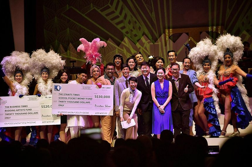 Mr Shaw Jia Hong (centre, in black) presented two cheques to two charities after the curtain call last night. With him are the musical's producer Tan Kheng Hua (next to him, wearing a scarf); ST managing editor Fiona Chan (in blue); Mr Tan Tee Tong (