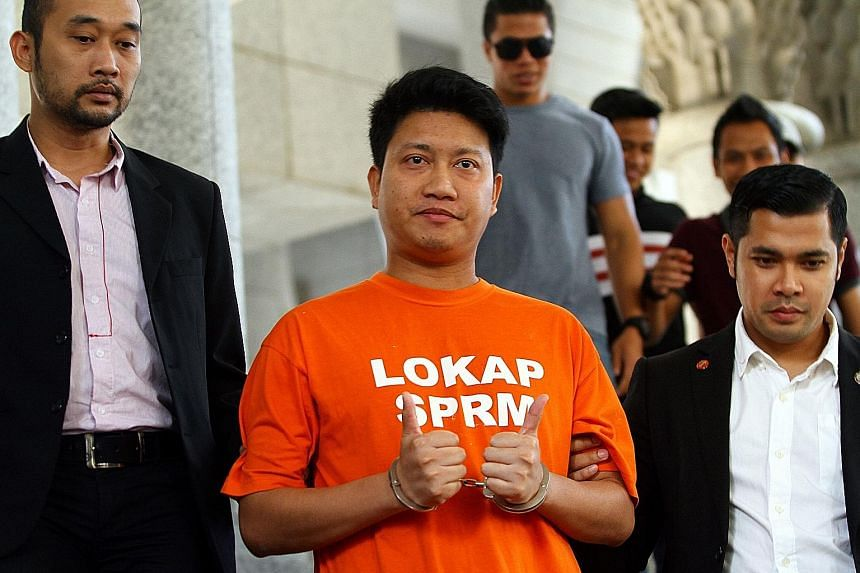 """Parti Keadilan Rakyat's Ampang youth chief Adam Rosly arriving at the Ampang court complex yesterday. The Malaysian Anti-Corruption Commission was allowed to remand him for five days, until next Tuesday, to investigate him over his """"unusual"""" wealth,"""