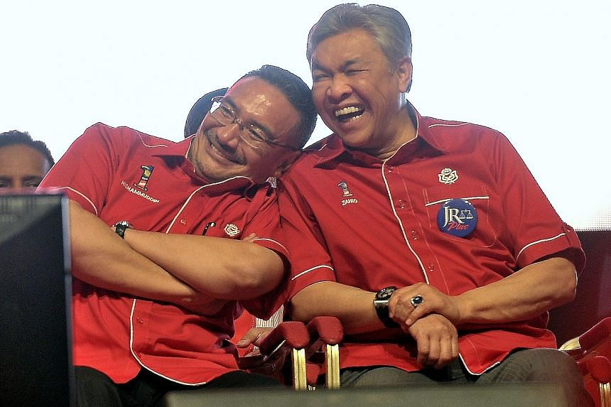 Datuk Seri Hishammuddin Hussein was appointed Special Functions Minister on Tuesday, in addition to being Defence Minister, sparking discussions of a rift between him and Deputy Prime Minister and Home Minister Ahmad Zahid Hamidi (far right). But the