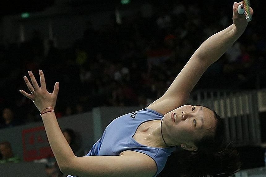 Zhang Beiwen, representing the United States, stretching to return a shot against world No. 4 Akane Yamaguchi of Japan in their quarter-final. She won to set up a clash with top-ranked Tai Tzu-ying.