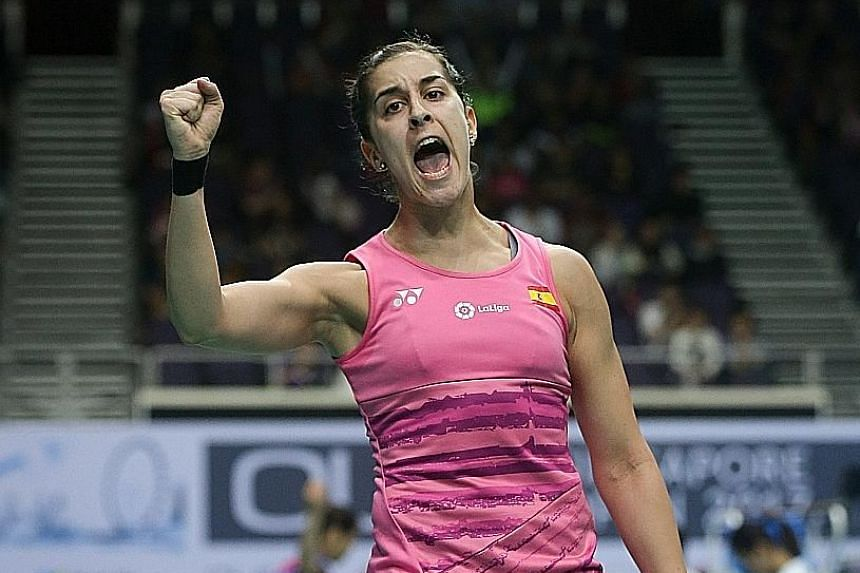 Spain's Carolina Marin celebrates winning a point against India's P.V. Sindhu. The reigning Olympic champion never trailed in either game, winning 21-11, 21-15 in 35 minutes.