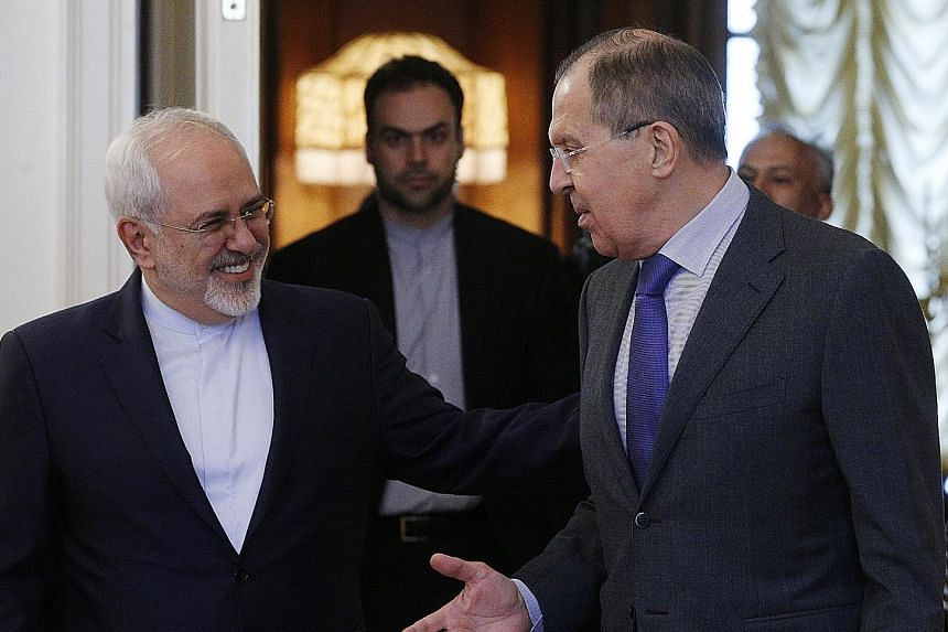 Russian Foreign Minister Sergei Lavrov (right) and his Iranian counterpart, Mr Mohammad Javada Zarif, ahead of talks with Syrian officials in Moscow yesterday on the situation in Syria.
