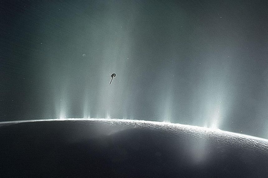 A Nasa photo showing the Cassini spacecraft diving through the plume of Saturn's moon, Enceladus, in 2015.