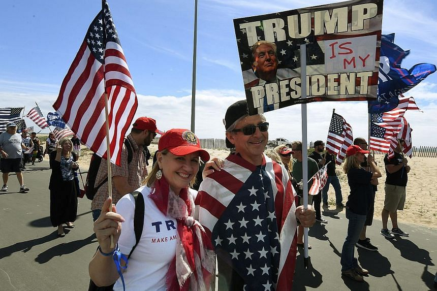A rally for US President Donald Trump last month in Huntington Beach, California. His recent policy flip-flops have soothed the nerves of many Republicans who were worried that he was looking to upend too much of the status quo, but left his most ste