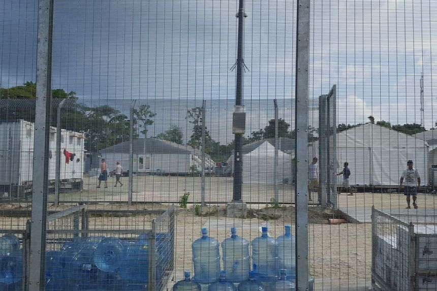 Detainees walking around in the compound of the Manus Island detention centre in Papua New Guinea on Feb 11, 2017.