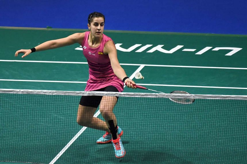 Carolina Marin of Spain playing a shot against PV Sindhu of India during the women's singles quarter-final of the Singapore Open badminton tournament, on April 14, 2017.