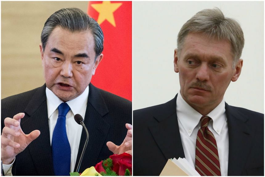 "Chinese Foreign Minister Wang Yi (left) called on all parties to refrain from provoking and threatening each other, while Kremlin spokesman Dmitry Peskov urged ""restraint"" and warned against any ""provocative steps""."
