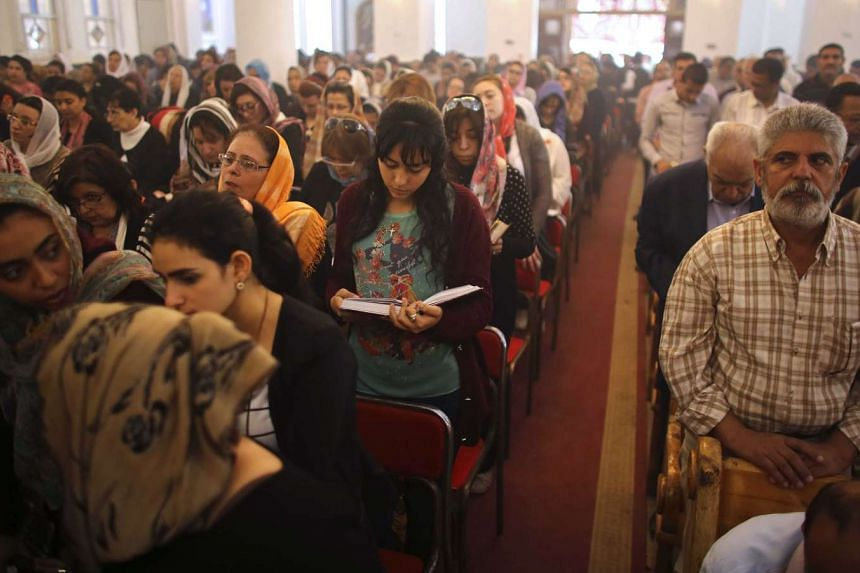 Egyptian Christians praying during the Good Friday service at St George church in the town of Mohalla on April 14, 2017.