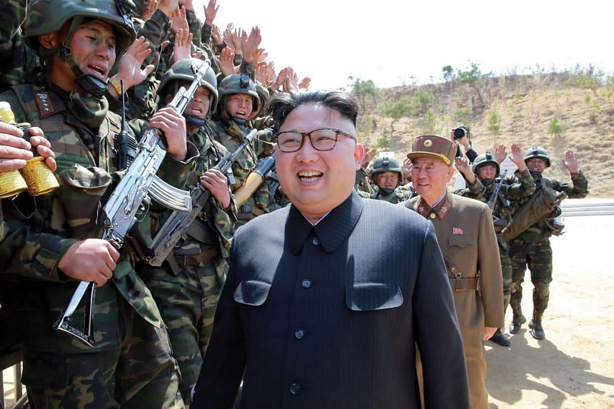 "An undated photo released by North Korea's official Korean Central News Agency on April 14, 2017, showing North Korean leader Kim Jong-Un inspecting the ""Dropping and Target-striking Contest of KPA Special Operation Forces - 2017"" at an undisclosed l"