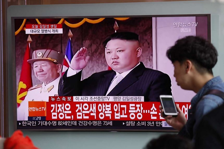 South Koreans watch a North Korean special news translation of a parade to mark the 105th anniversary of the birth of North Korea's founder Kim Il-Sung at the station in Seoul, South Korea, on April 15, 2017.