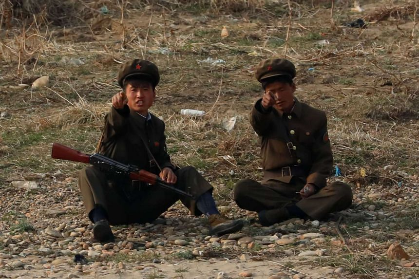 North Korean soldiers on the banks of Yalu river.