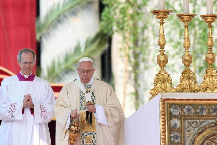 Pope Francis (centre) delivers an Easter mass in Saint Peter's Square at the Vatican, Vatican City, on April 16, 2017.