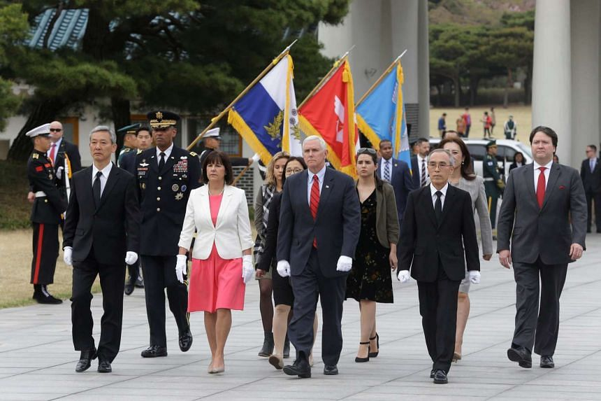 US Vice-President Mike Pence and his wife Karen arriving at the National Cemetery in Seoul.