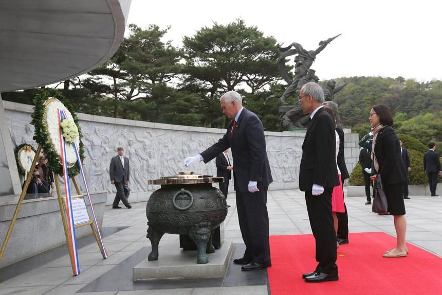 US Vice-President Mike Pence burns incense at the National Cemetery in Seoul.