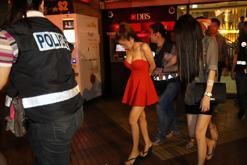 Scantily-clad women escorted by the police in a raid on April 15, 2017.
