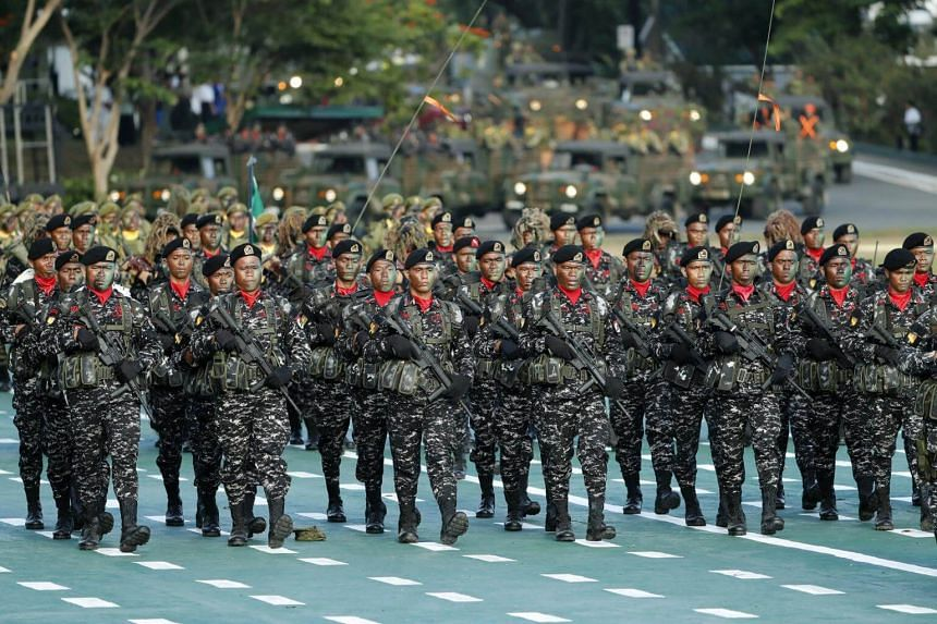 Filipino soldiers participate in a parade at a military camp in Taguig city, south-east of Manila, on April 4.