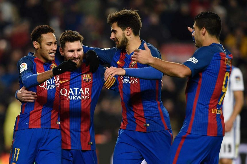 Messi (second left) celebrates his goal with Neymar (left), Andre Gomes (second right) and Luis Suarez.