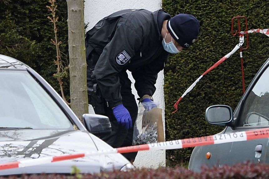A German police officer secures evidence at the site of an attack on the Borussia Dortmund team bus.