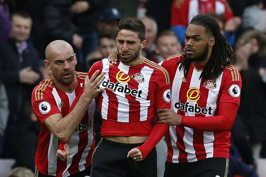 Sunderland's Fabio Borini celebrates scoring their second goal with Jason Denayer and Darron Gibson.
